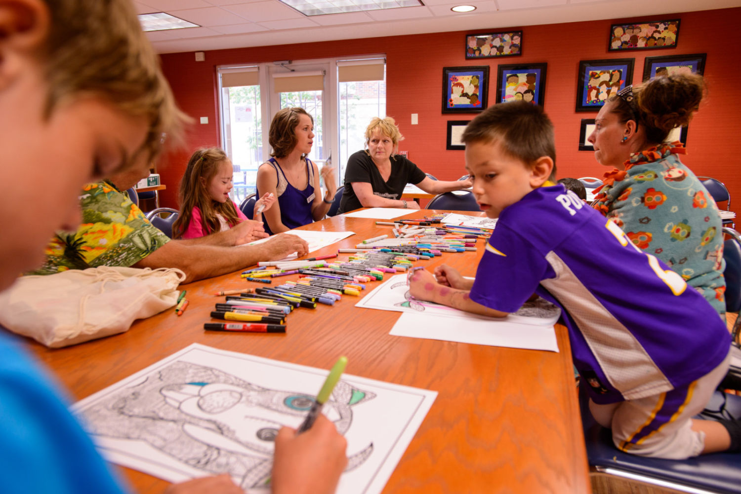 Group of children and adults coloring together