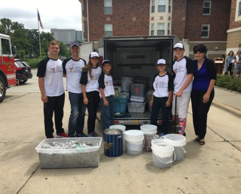 Bayles family delivering pop tabs to Ronald McDonald House
